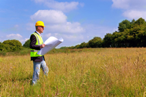 Property Surveyor Performing Surveying Work to Create a Certified Survey Map